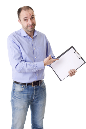friendly young man pointing to a sheet and looking into the camera. isolated on white background Stock Photo