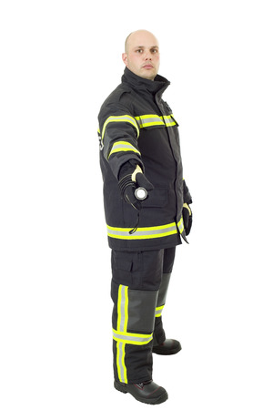 Serious firefighter with a flashlight. Full length studio shot isolated on white. Standard-Bild