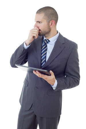 pensive businessman working with a tablet pc, isolated Stock Photo