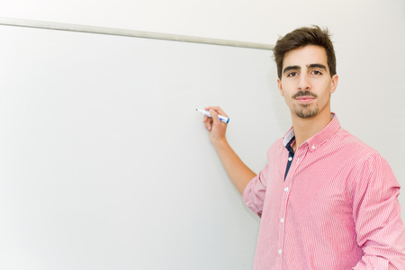 young man student at the school, on the whiteboard
