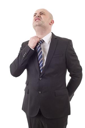 hombre de negocios preocupado en un traje mirando hacia arriba, aislado Foto de archivo