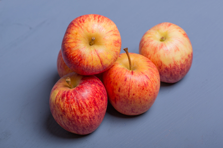 apples on a blue wooden table, studio picture
