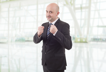 happy business man showing his fists at the office