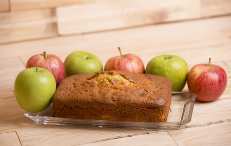 Delicious apple cake on wooden table