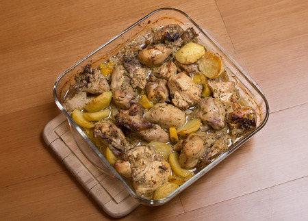grilled chicken with potatoes, on wooden table