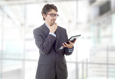 young businessman with a tablet pc, at the office Stock Photo