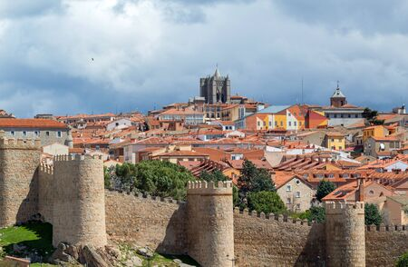 Panoramic view of the historic city of Avila from the Mirador of Cuatro Postes, Spain, with its famous medieval town walls. Stock Photo