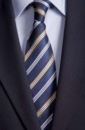 Businessman detail, close up jacket men's shirt with a blue tie