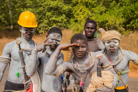Bissau, Republic of Guinea-Bissau - young men warriors with traditionally painted face