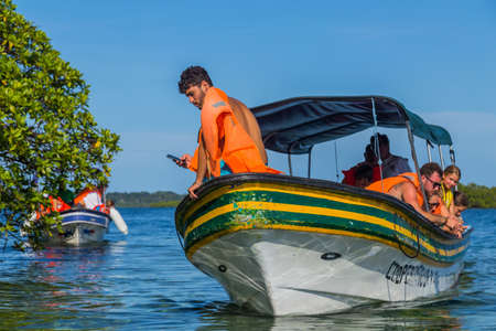 Bocas Del Toro, Panama: Tourists looking for marine life on a boat at Bocas del Toro, Panama