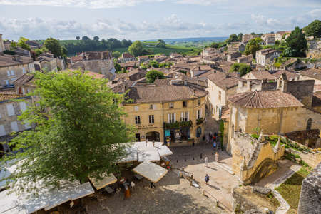 Saint Emilion, France: People enjoying the view of the centre of the old medieval town of saint emilion, in aquitaine, france 에디토리얼