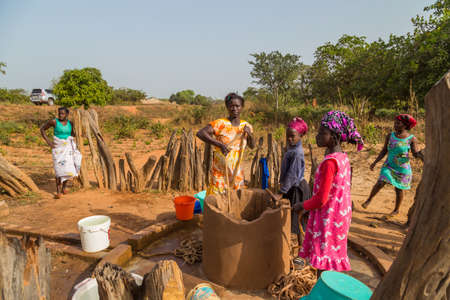 Bissau, Republic of Guinea-Bissau: women and children at the well for water, in the city of Bissau, Guinea Bissau