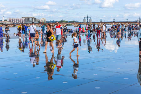 BORDEAUX, FRANCE: The Famous Bordeaux water mirror full of people having fun in the water, in Bordeaux, France.