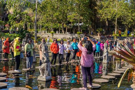 Bali, Indonesia: People walking on the stepstones of Tirtagangga Water Palace in Bali, Indonesia 에디토리얼