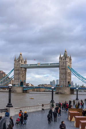 London, UK: Unidentified people around Tower bridge over the River Thames