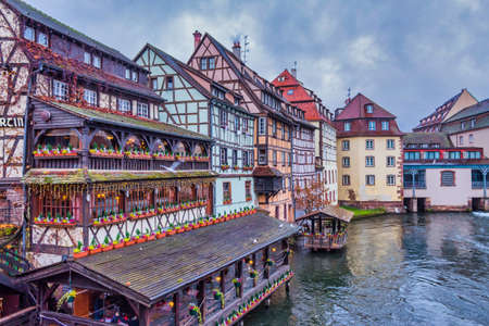 COLMAR, FRANCE: people visit the area little venice with traditional buildings in the old town of Colmar.