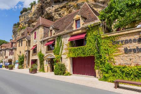 La Roque-Gageac, Dordogne, France: People visiting La Roque-Gageac scenic village on the Dordogne river, France