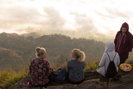 BALI, INDONESIA: Group of young people watch the dawn on top of the Batur volcano in Bali, Indonesia.