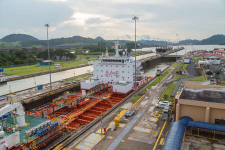 MIRAFLORES, PANAMA: BIG ship is passing through Miraflores Locks, part of Panama Canal. Editorial