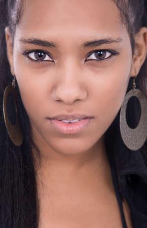 Happy african girl close up portrait, studio picture