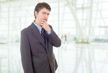 young business man thinking, at the office