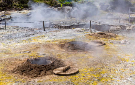 Boiling water and hot steam venting from Caldeira Grande in the small town of Furnas, Sao Miguel island in Azores, Portugal