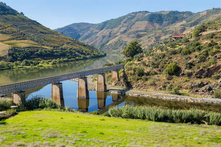 Scenic view of the Douro Valley and river with terraced vineyards near the village of Tua, Portugal