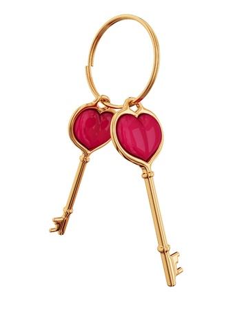 Zlatý klíč s trochou srdcem uvnitř. 3D vykreslen. Samostatný na bílém pozadí. Reklamní fotografie