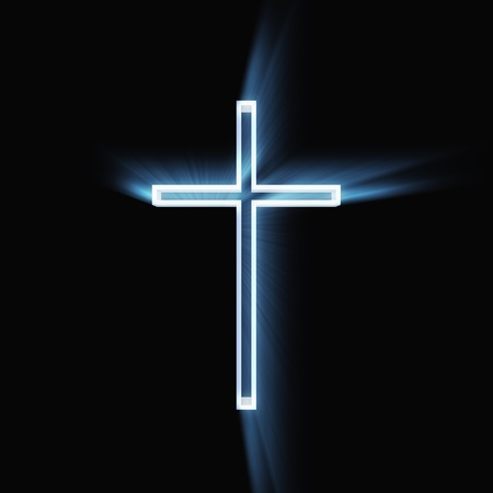 Glowing christian cross isolated on black background. photo