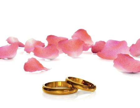 Golden wedding rings with rose petals. Isolated on white.3d rendered. photo