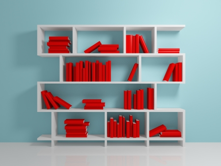 White bookshelf with a red books against blue wall. photo