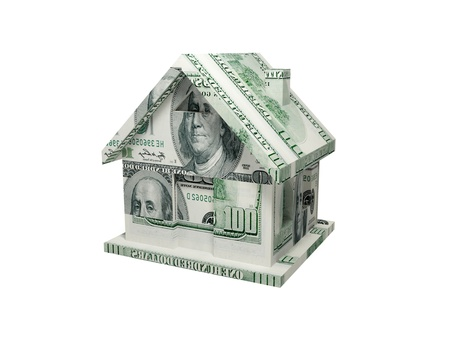 sold: House made of money. 3d rendered. Isolated on white. Stock Photo