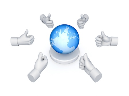 Hands with thumbs up around globe  photo