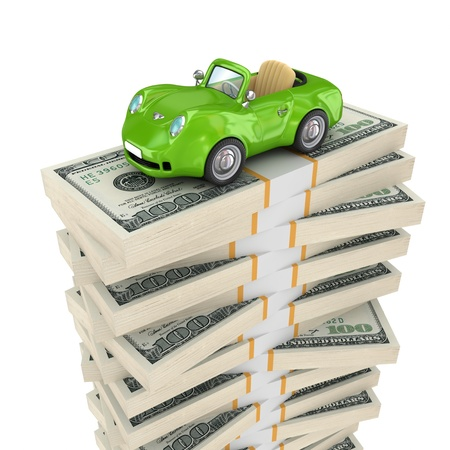 Small green car on a big pack of dollars  photo