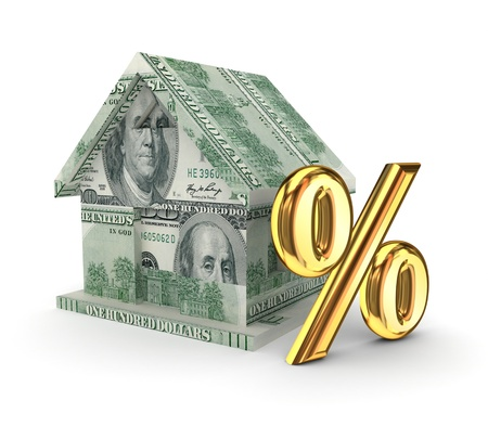 Small house and golden percents symbol  Stock Photo