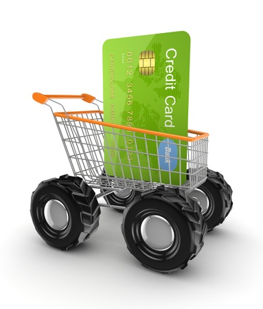 online transaction: Green credit card in a shopping trolley