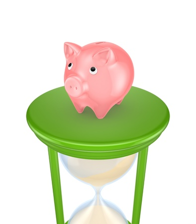 Pink piggy bank on a green sand glass  Stock Photo - 15649897