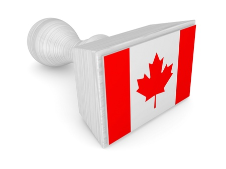 Wooden stamp with canadian flag  photo