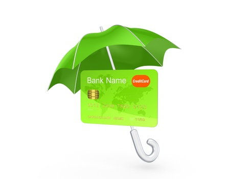 Credit card under green umbrella Stock Photo - 20224437