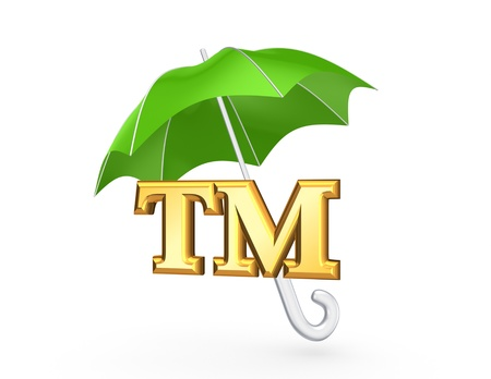 tm: TM symbol under green umbrella  Stock Photo