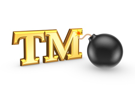 warrant: TM symbol and black bomb  Stock Photo