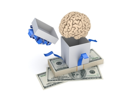pack of dollars: Human brain at a gift box and big pack of dollars. Stock Photo