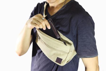 waist belt: take the wallet  from waist belt bag Stock Photo