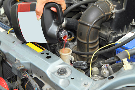 pour the coolant in the car