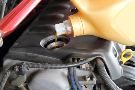 engine oil: pouring oil machine Stock Photo