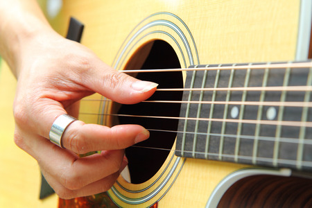 Finger picking the guitar Stock Photo