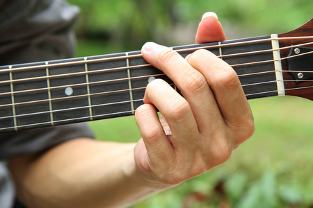 chord: playing guitar chord G  playing guitar in the park
