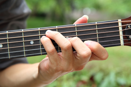 Playing Guitar Chord F Playing Guitar In The Park Stock Photo ...