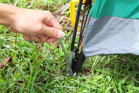 push the tent anchor to the ground