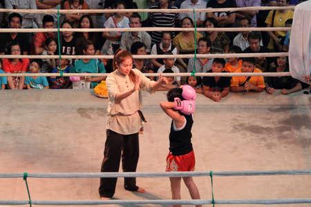count down: Bangkok, Thailand - November 14, 2015 :Unidentified Thai boxing referee count down to a boxing girl ,Bangkok, Thailand Editorial